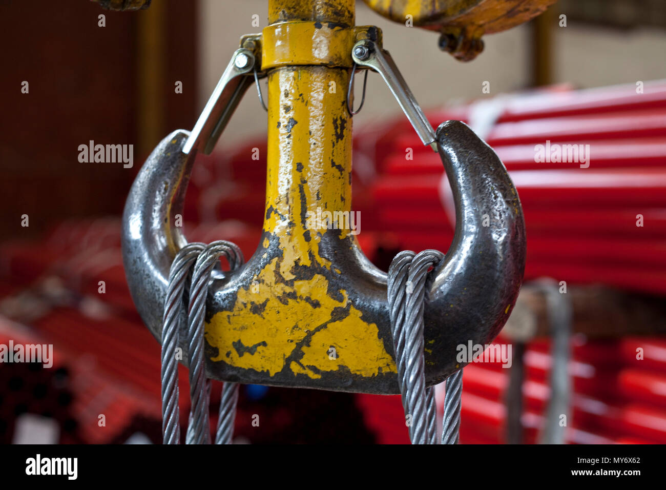 closup on yellow industrial hook with steel cables Stock Photo