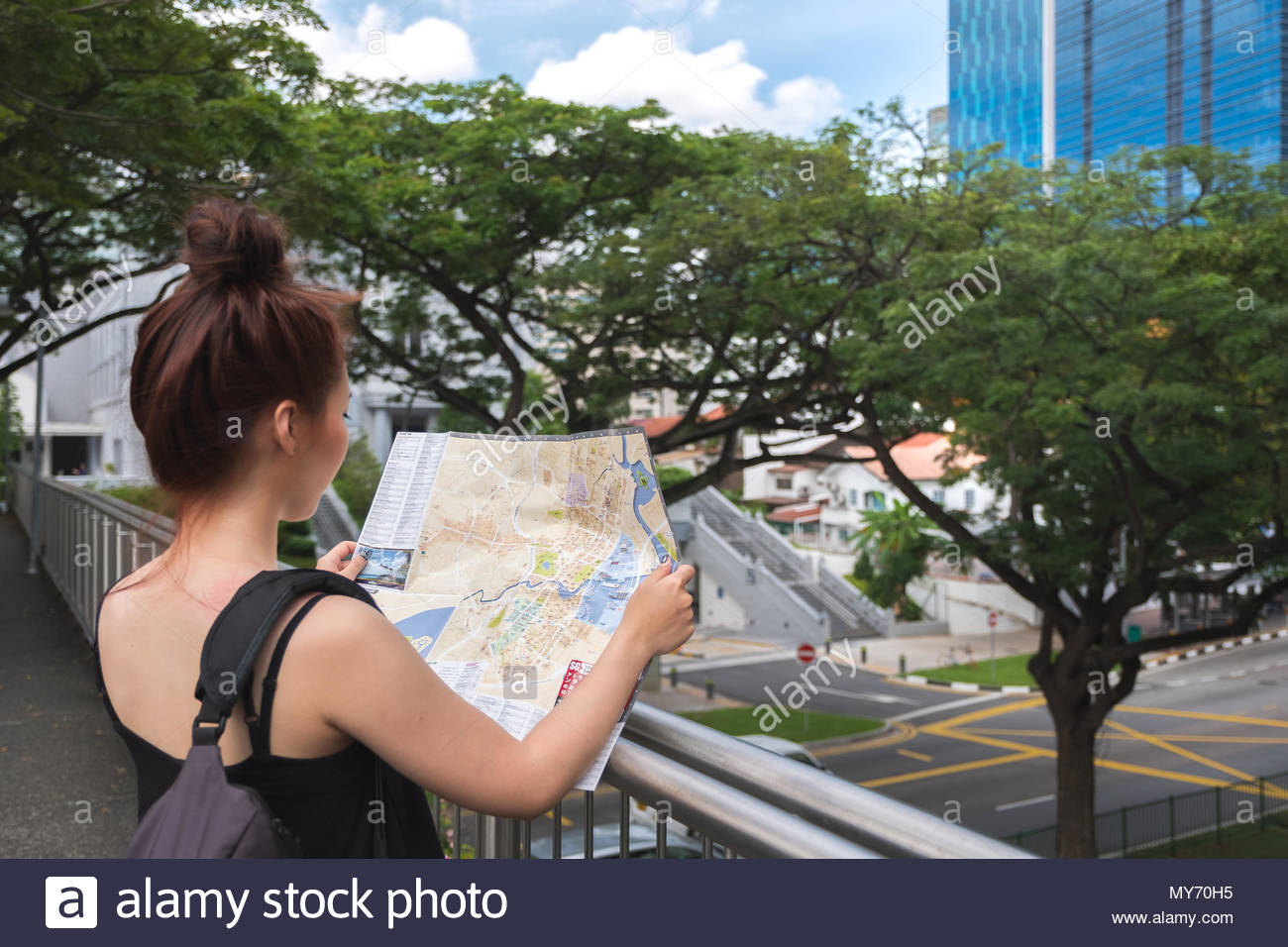 Young asian woman traveler holding map to find direction in ... on