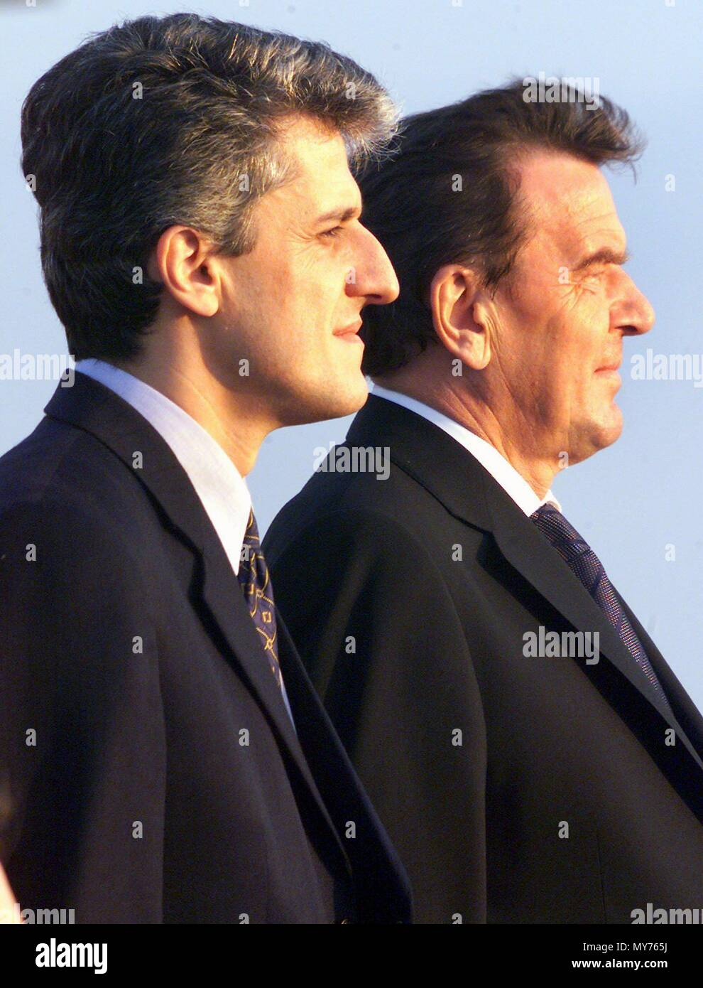 German Chancellor Gerhard Schroeder (R) and Albanian Prime Minister Pandeli Majko listen to the national anthems of both countries at the airport in Tirana, Albania, on 22 September 1999. Schroeder was received with military honours after his arrival in Albania.   usage worldwide - Stock Image
