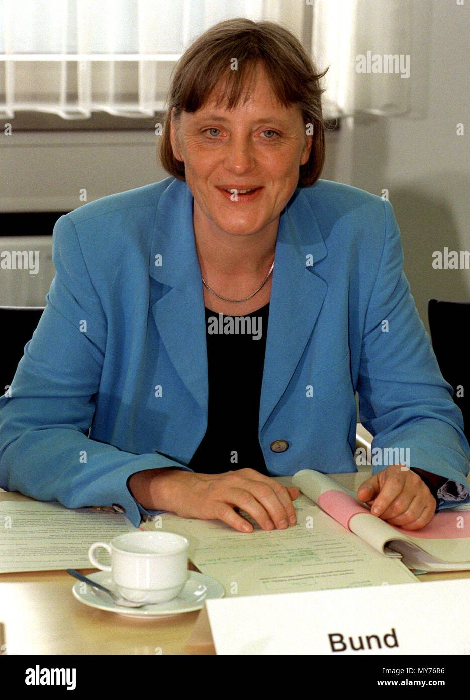 German Environment Minister Angela Merkel with documents before talks with German state environment ministers at the German Environment Ministry in Bonn, Germany, on 2 June 1998.  | usage worldwide - Stock Image