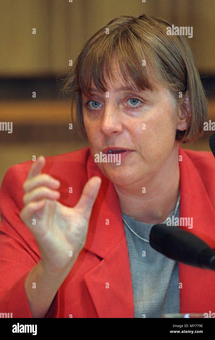 German Environment Minister Angela Merkel (CDU) answers journalists' questions during a press conference on the presentation of the Federal Environment Agency's annual report for 1997 in Bonn, Germany, on 1 September 1998. | usage worldwide - Stock Image