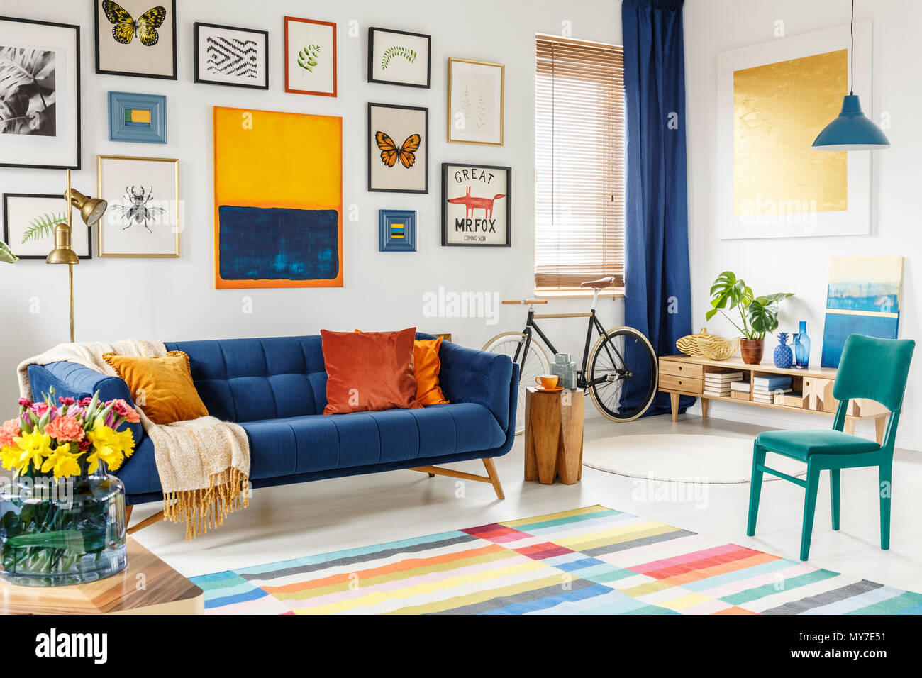 Spacious living room interior with a blanket and orange ...