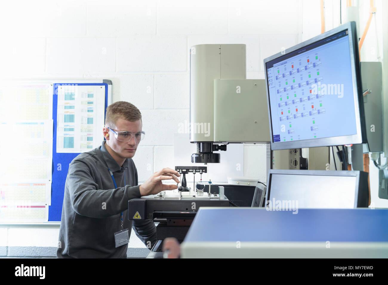 Engineer in test laboratory in metal pressing factory - Stock Image