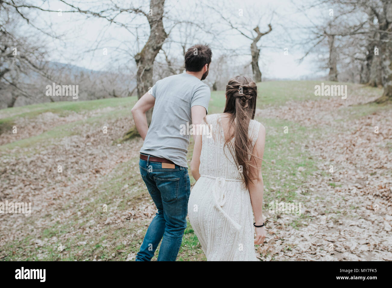 Couple walking in park - Stock Image