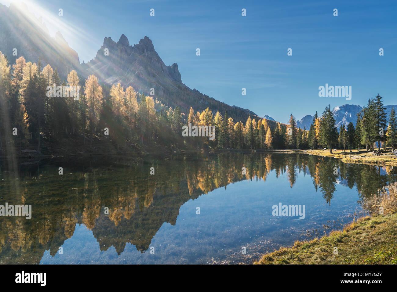 Sun over lake, Dolomites, Cortina d'Ampezzo, Veneto, Italy - Stock Image