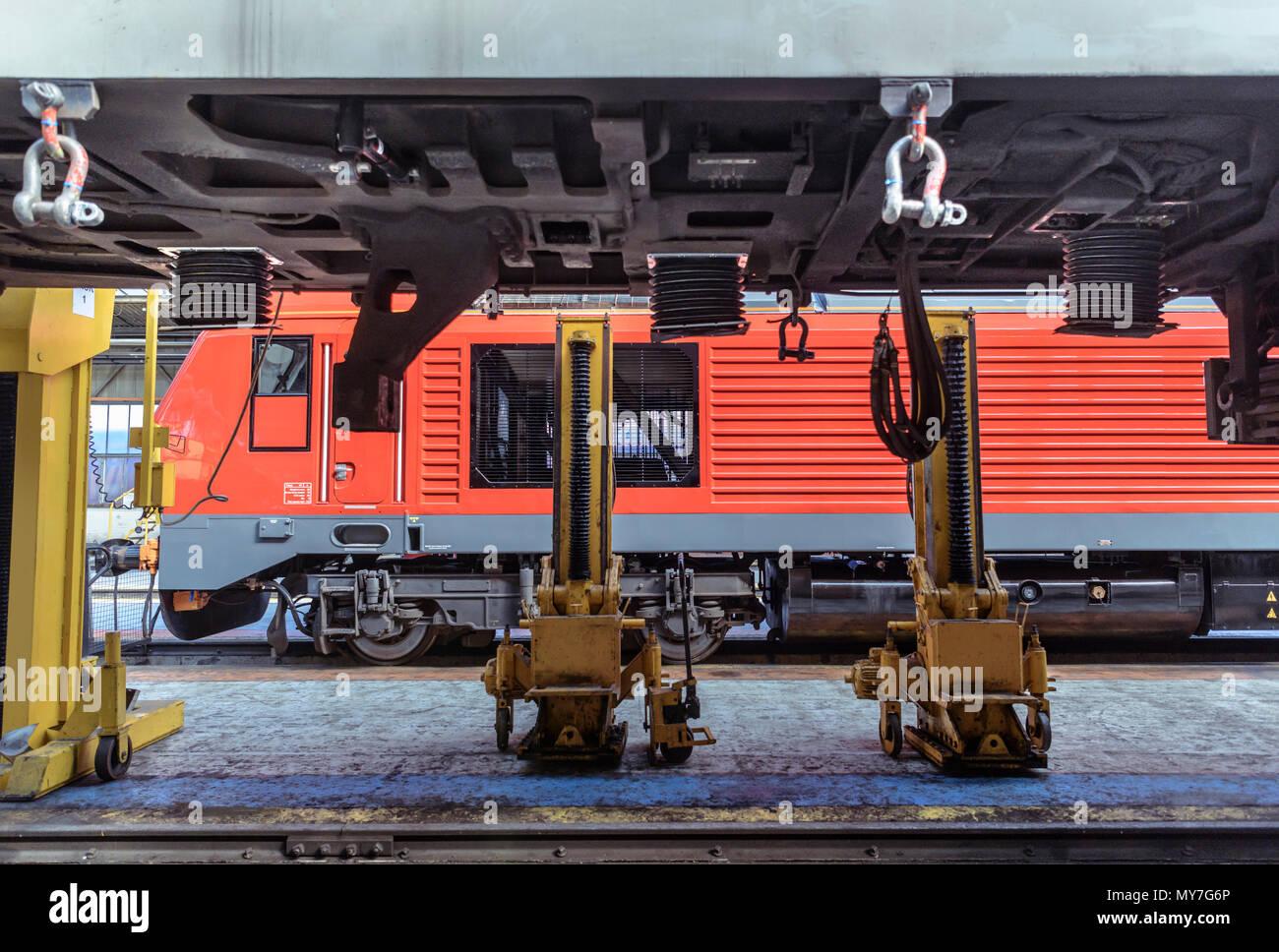 Refurbished locomotive in train engineering factory - Stock Image