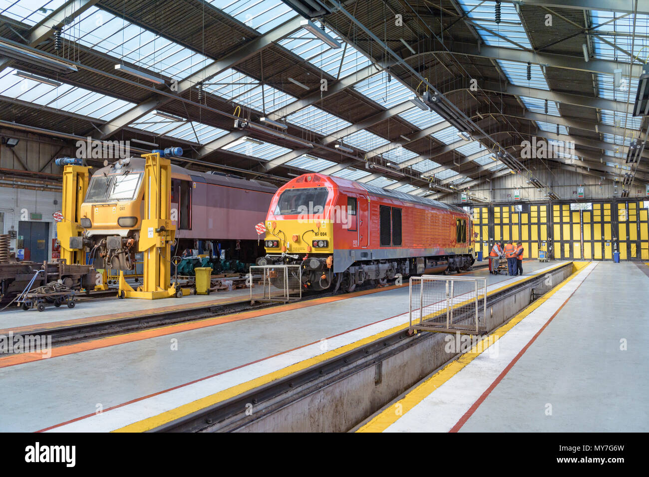Locomotive being refurbished in train engineering factory - Stock Image