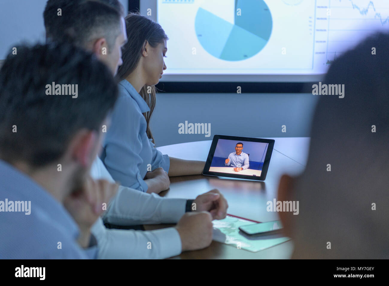 Business team with video conference with digital tablet during business meeting - Stock Image