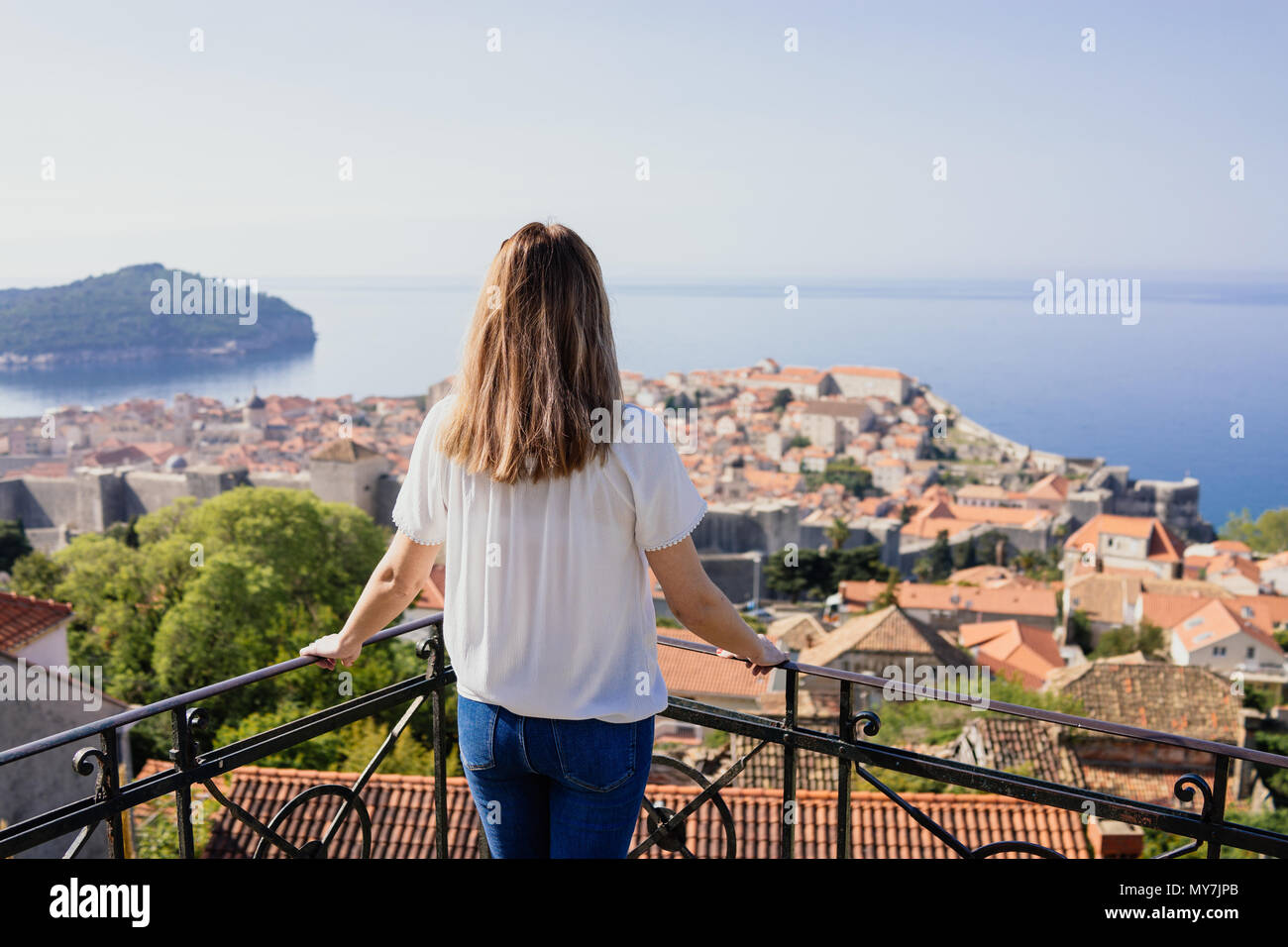 Woman looking at Dubrovnik old town - Stock Image
