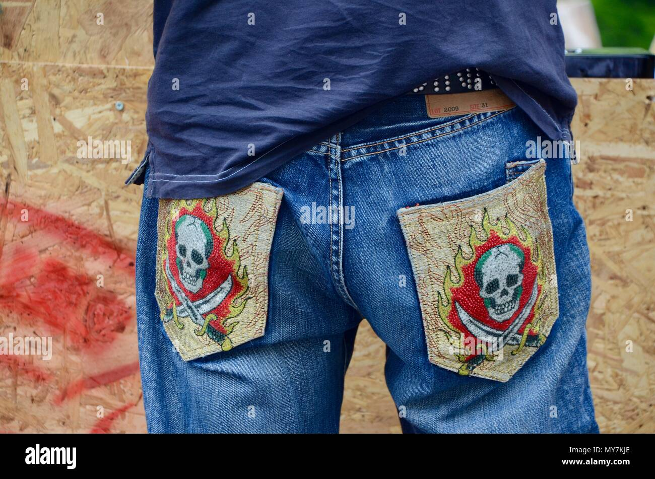 50283bc6 skull and sword patches on the back pockets of a pair of levi jeans london  UK