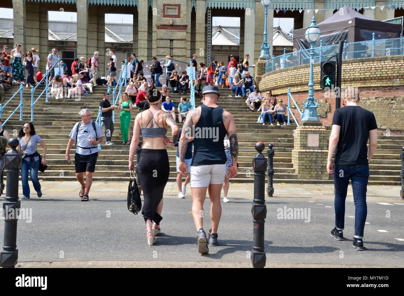 muscle bound tattooed couple at the street food festival at alexandra palace london UK 2018 - Stock Image