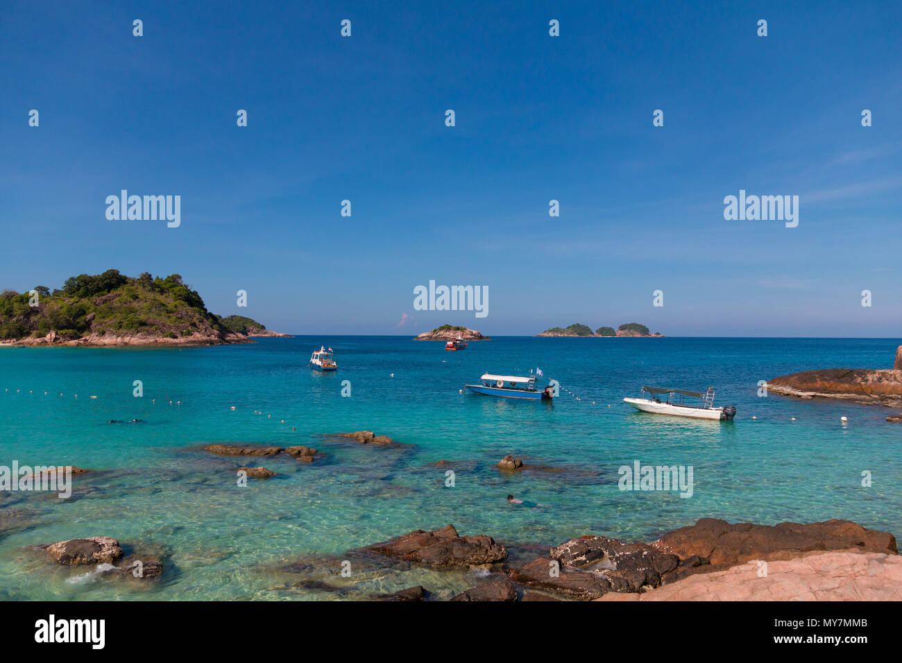 A nice view from the rocky part of Long Beach (Pasir Panjang) towards the South China Sea with the two islands, Pulau Paku Kecil and Pulau Lima. - Stock Image