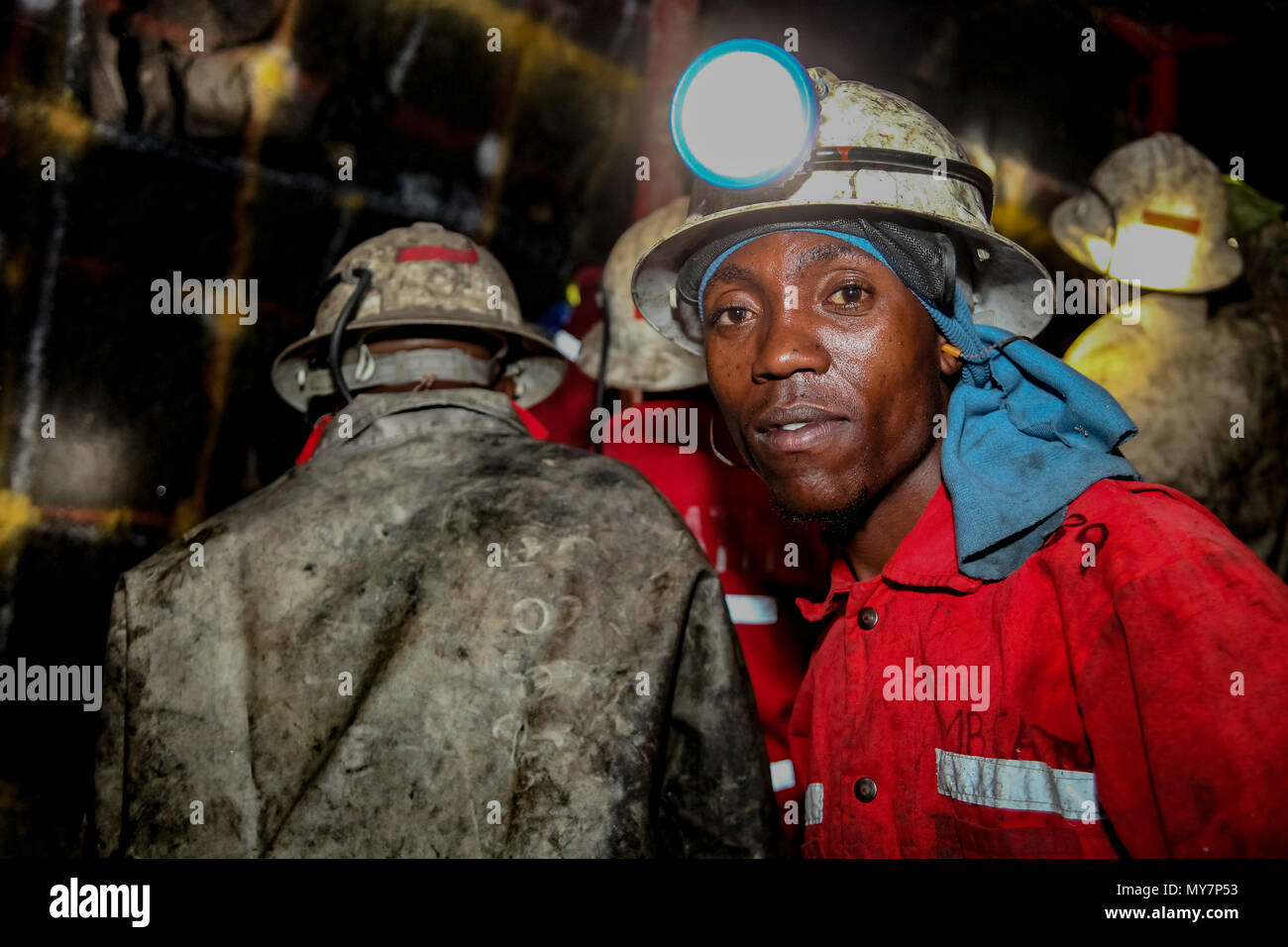 Rustenburg, South Africa, May 23, 2011, Underground Platinum Chrome miners drilling holes in rock for blasting. Holes used for dynamite placement - Stock Image