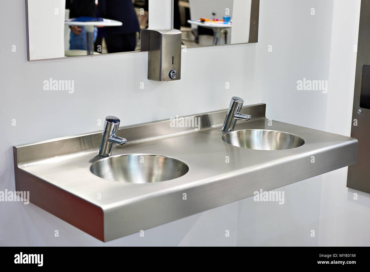 Metal sink with faucets in public toilet Stock Photo: 188875056 - Alamy