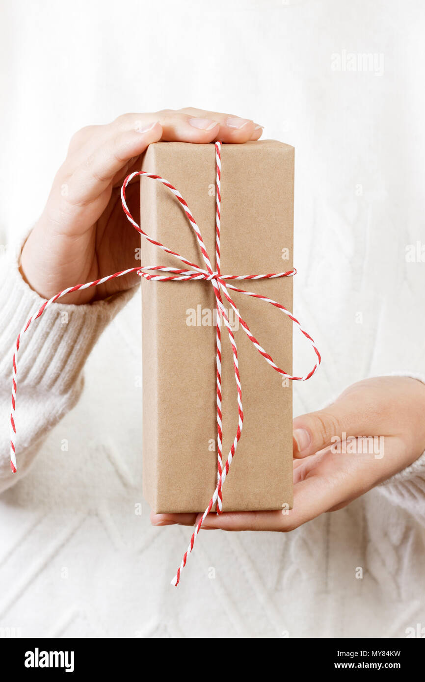 Celebrate year 2018. Woman hand holding golden gift box for Christmas and Happy new year 2018 background - Stock Image