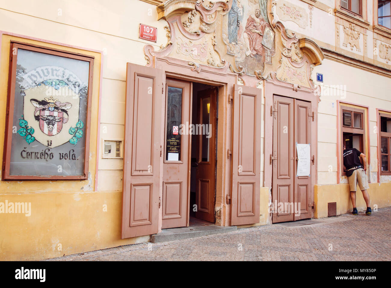 Prague, Czech republic, May 26, 2018: Traditional Pub U cerneho vola at Prague Castle area - Stock Image