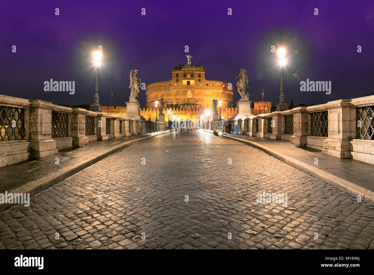 Saint Angel Castle and bridge at night in Rome, Italy. - Stock Image