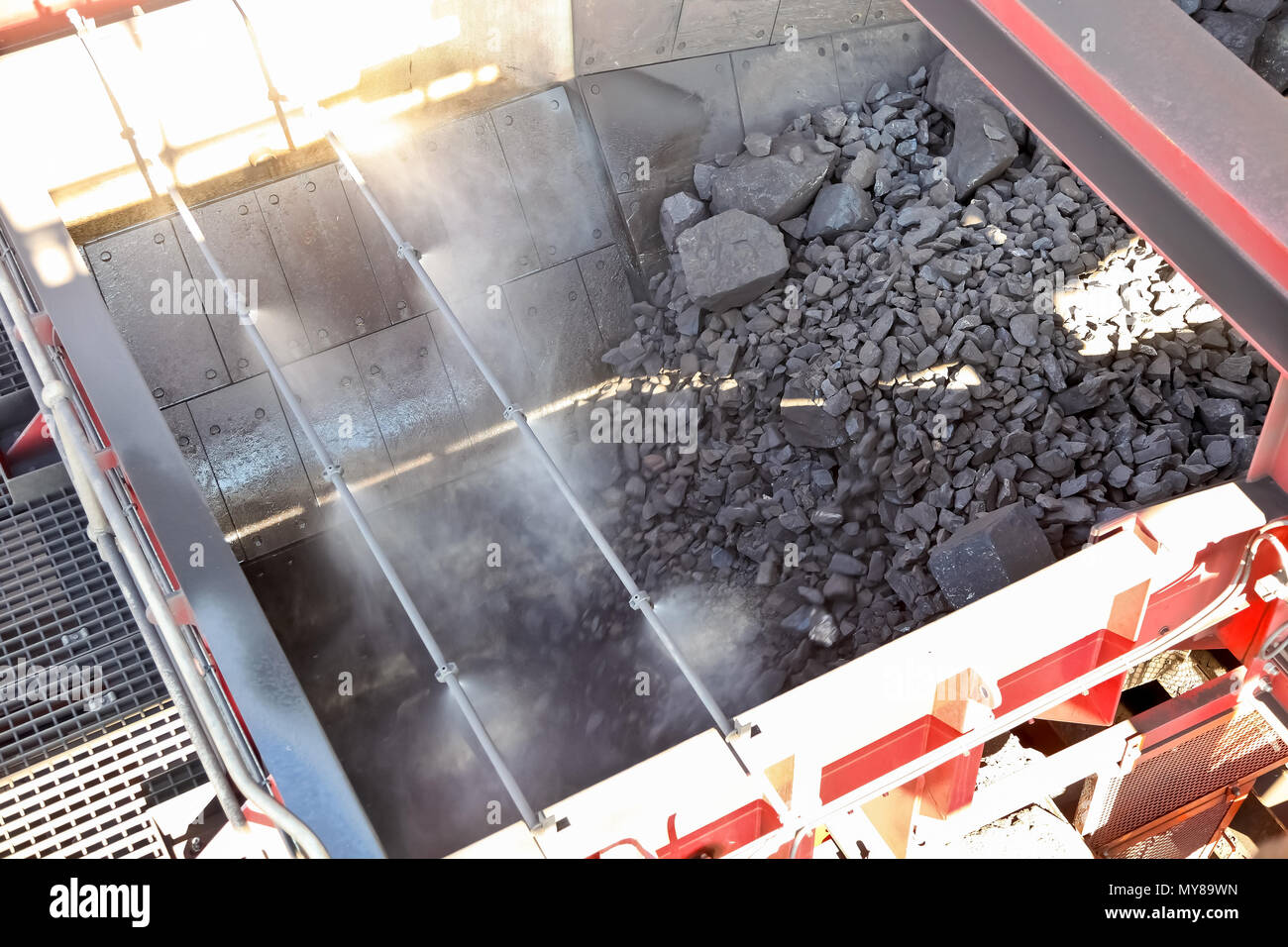 Manganese Mining and processing of ore rich rocks in wash bay - Stock Image