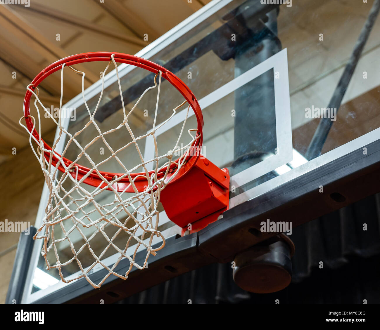 a basketball goal and backboard with lots of handprints on it - Stock Image