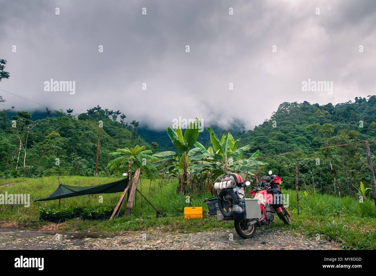 Motorbike and hammock in rural setting, Quito, Pichincha, Ecuador - Stock Image