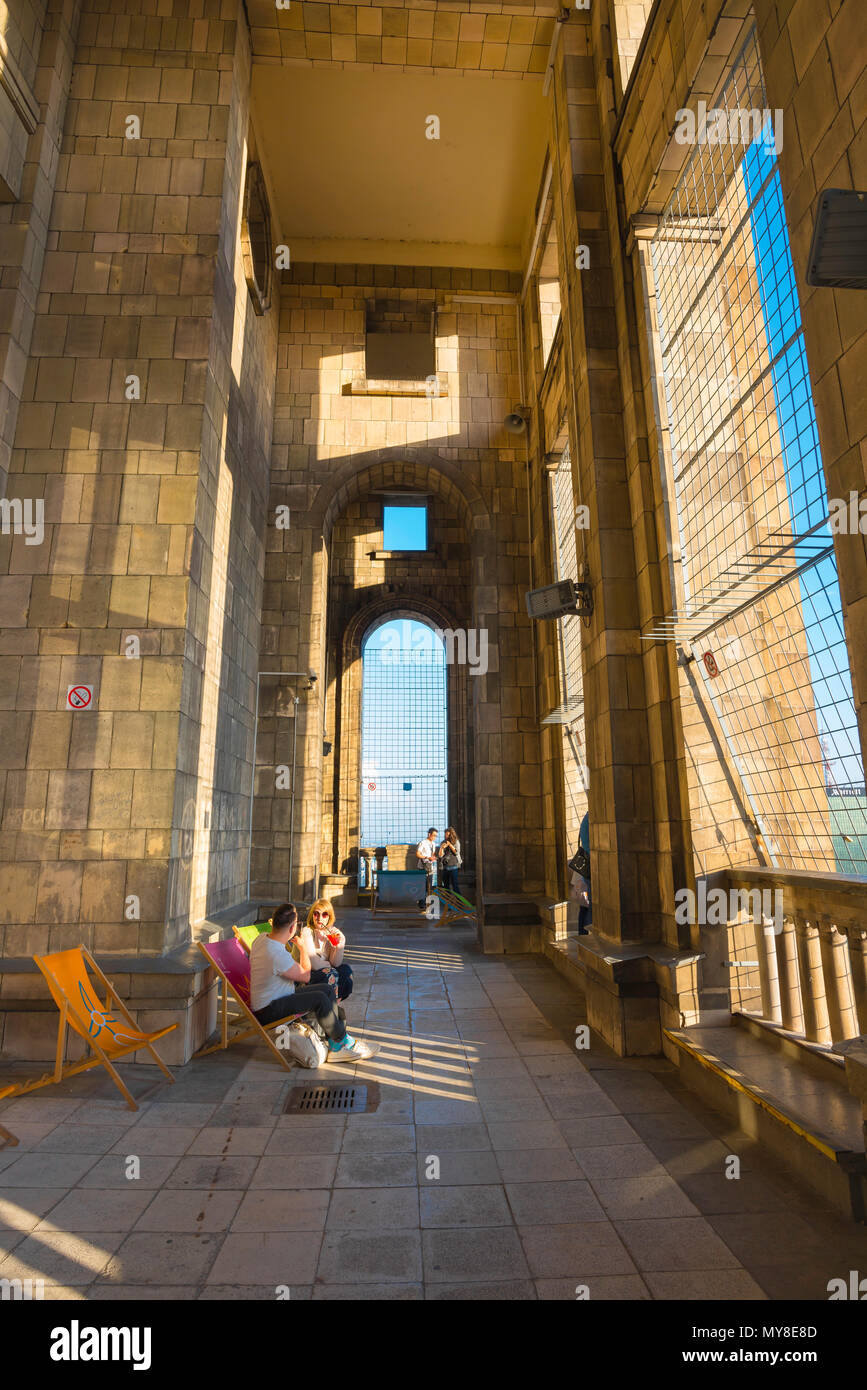 View of tourists inside the observation terrace at the top of the Palace Of Science And Culture in the center of Warsaw, Poland. - Stock Image