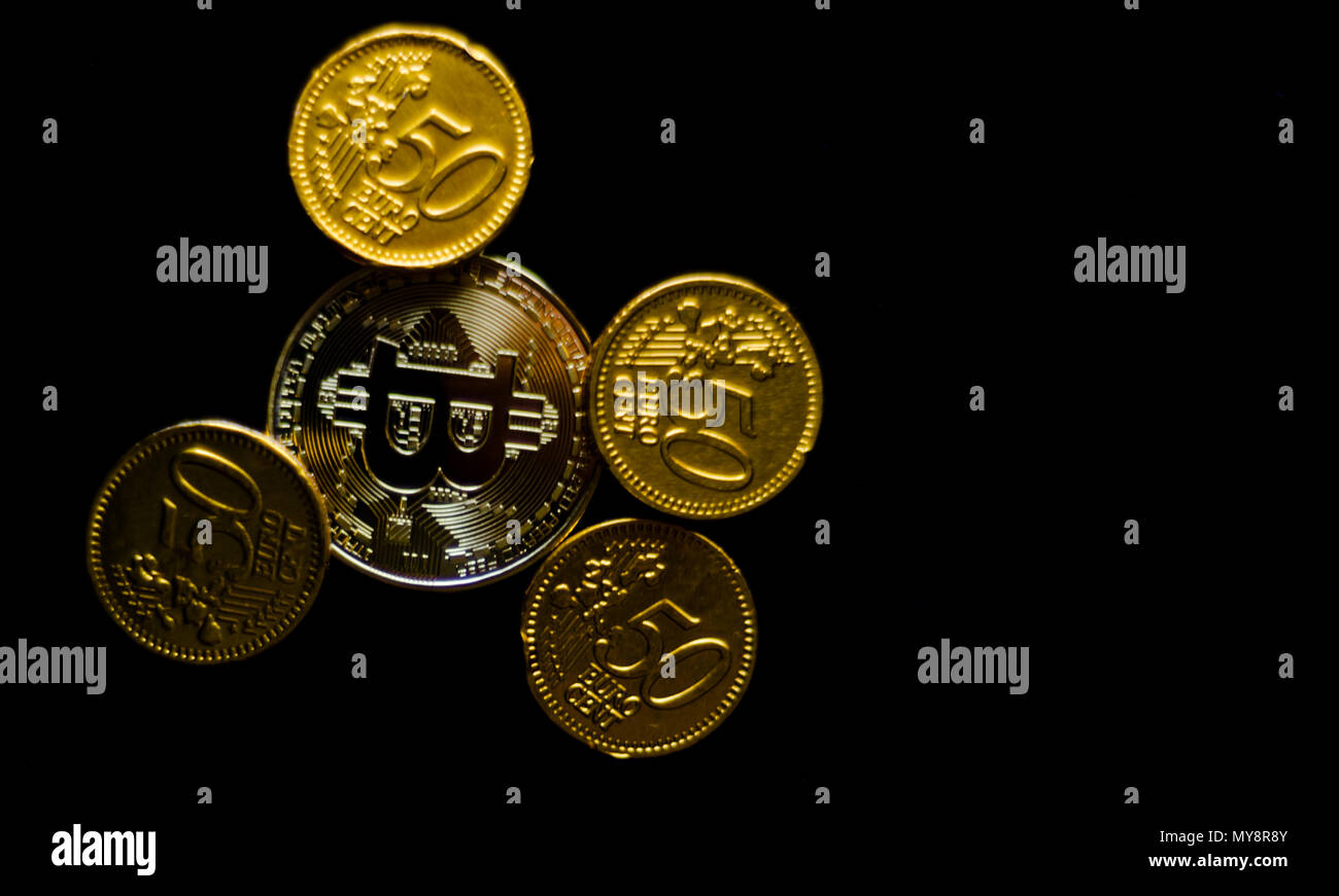 Crypto currency Gold Bitcoin with chocolate euro, BTC, macro shot of