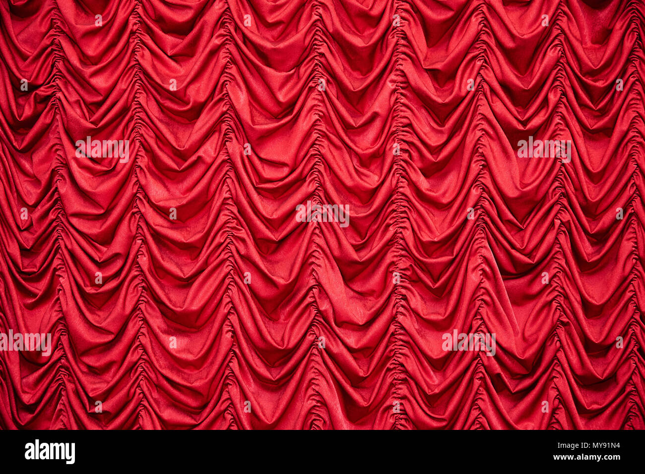 Red draped curtains - Stock Image