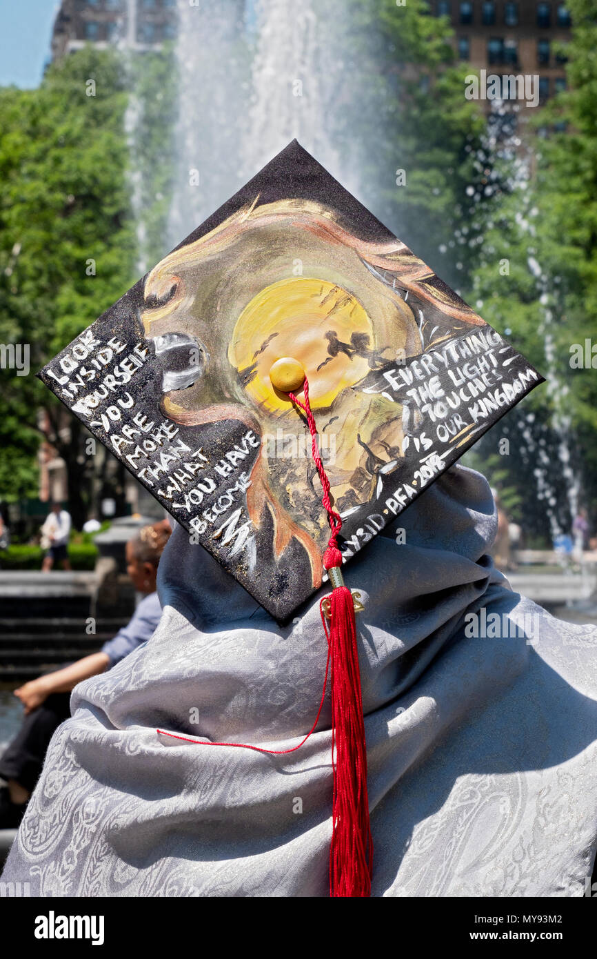 A graduate of the New York School of Interior Design with a cap quoting Simba from the Lion King. In Washington Square Park in Greenwich Village. - Stock Image