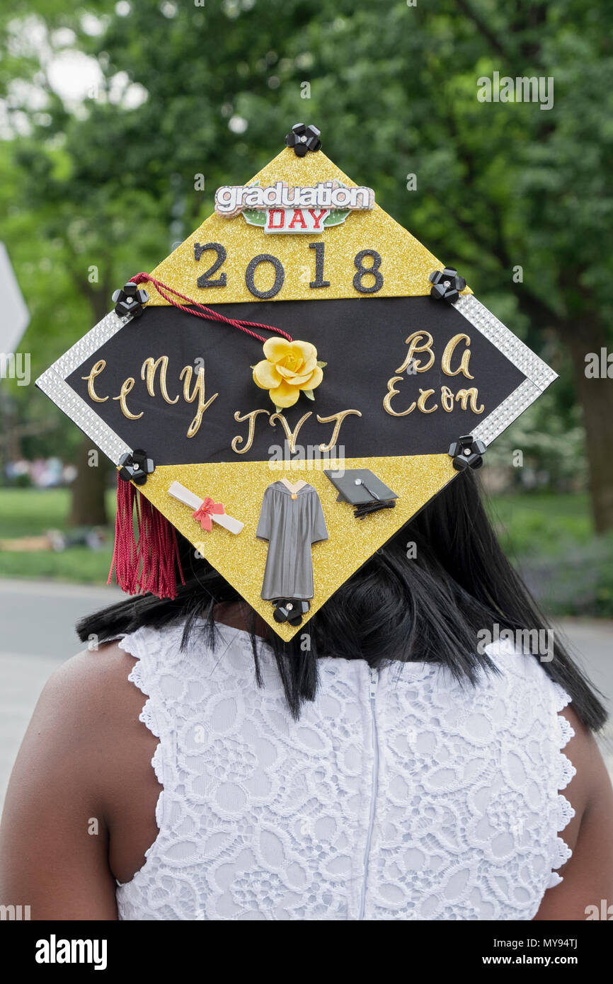 A Economics graduate of CCNY with an ornate original graduation cap in Washington Square Park in Greenwich Village. - Stock Image