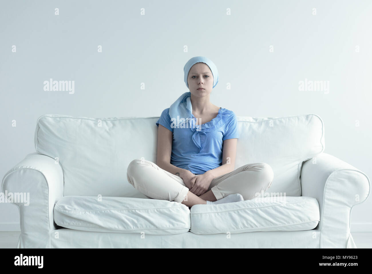 Woman suffering for alopecia becasue of radiation therapy - Stock Image