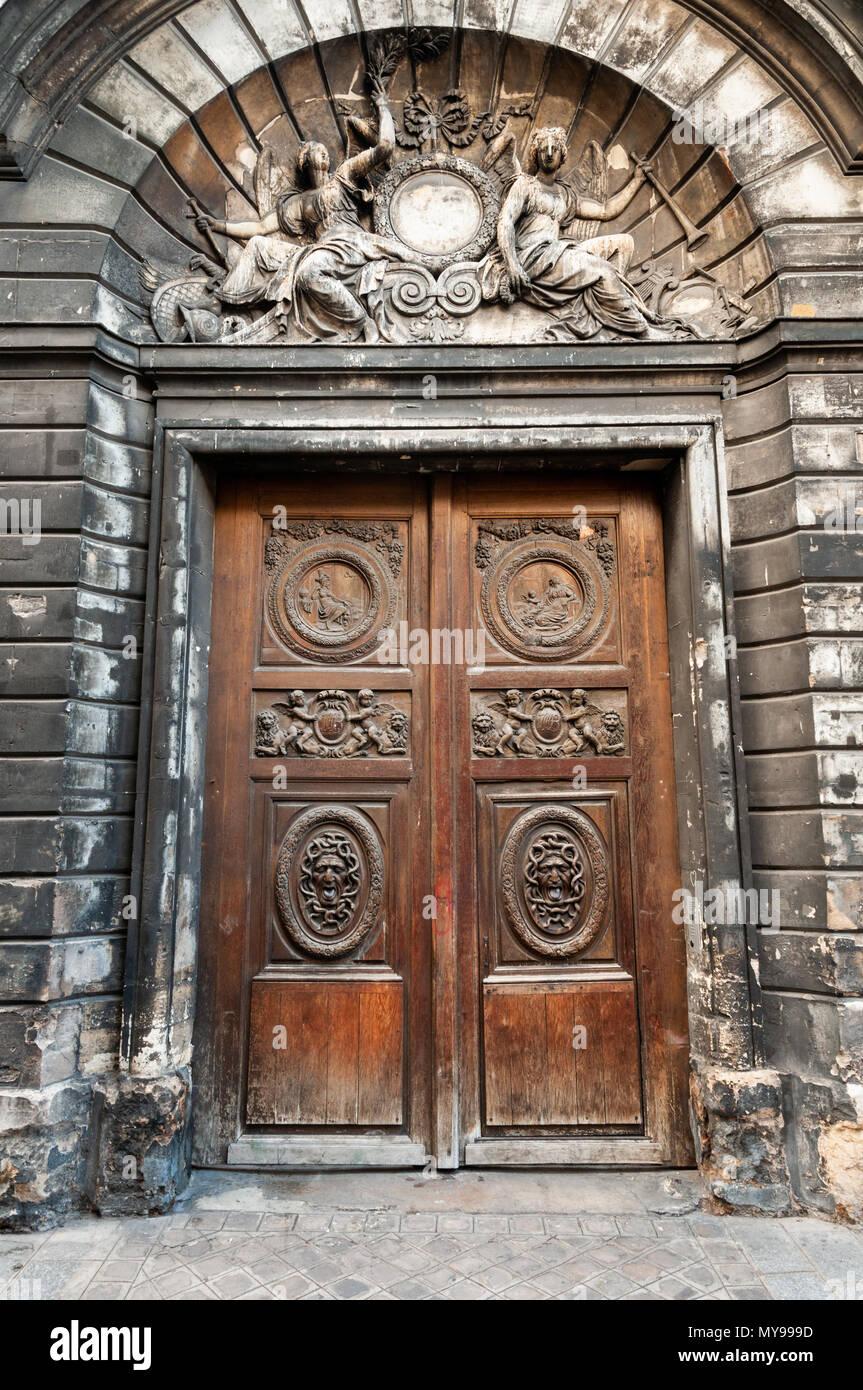 Big old wooden door in Rue Vieille du Temple, Le Marais, Paris, France - Stock Image