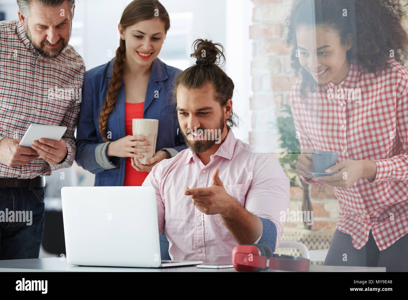 Workers of advertising agency working on new campaign Stock Photo