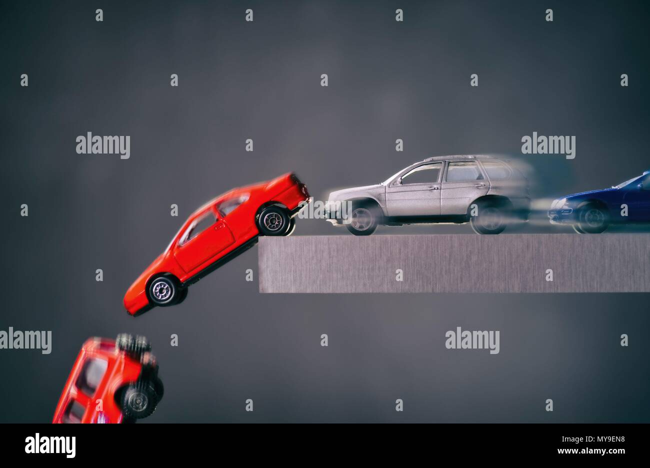Cars drive to an abyss and crash   usage worldwide Stock Photo ...