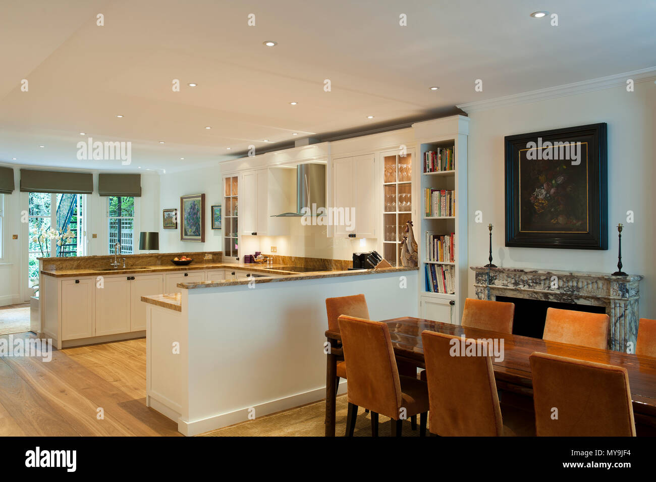 Country style open plan dining room and kitchen - Stock Image