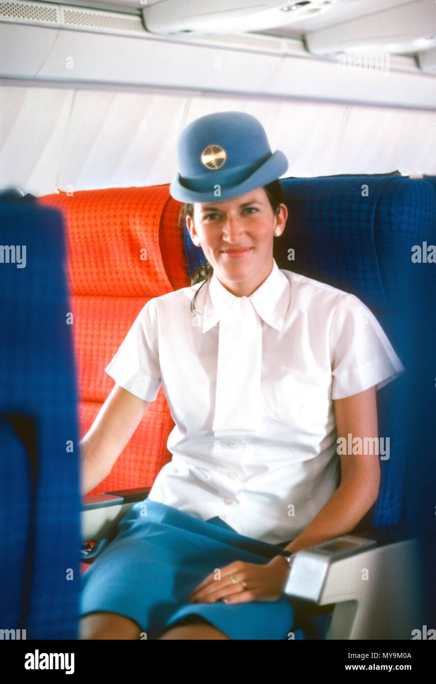 PanAm Flight Attendant Seated in a 707 Passenger Jet. - Stock Image
