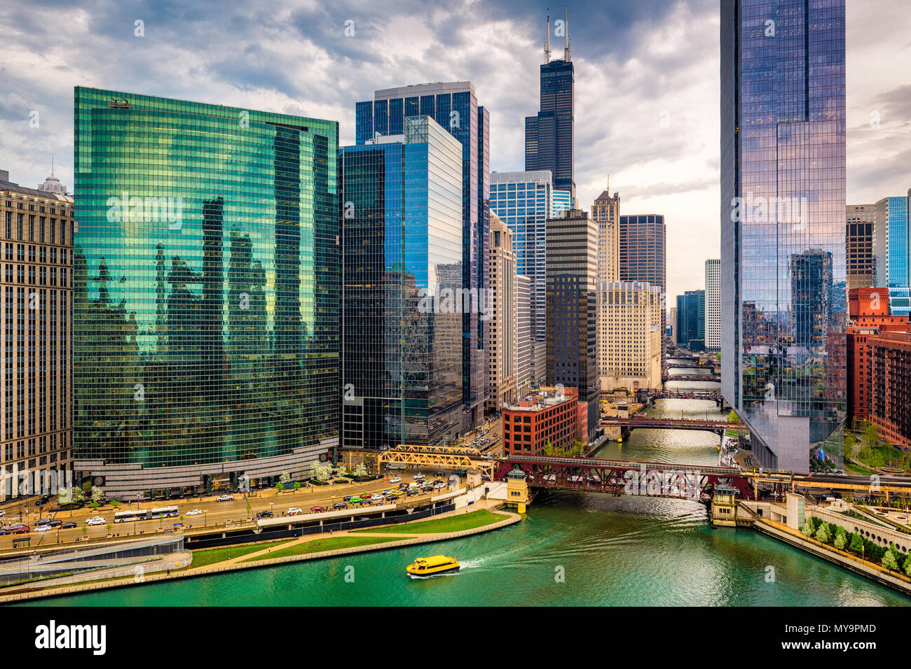 Chicago, Illinois, USA cityscape over the river at twilight. - Stock Image