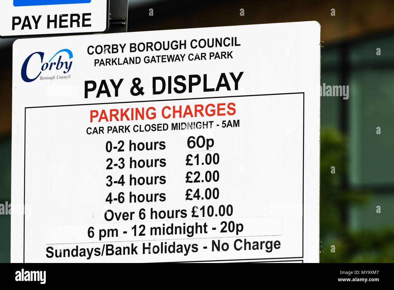 Car park pay and display parking charges notice outside the Cube in the town of Corby, Northamptonshire, England. - Stock Image