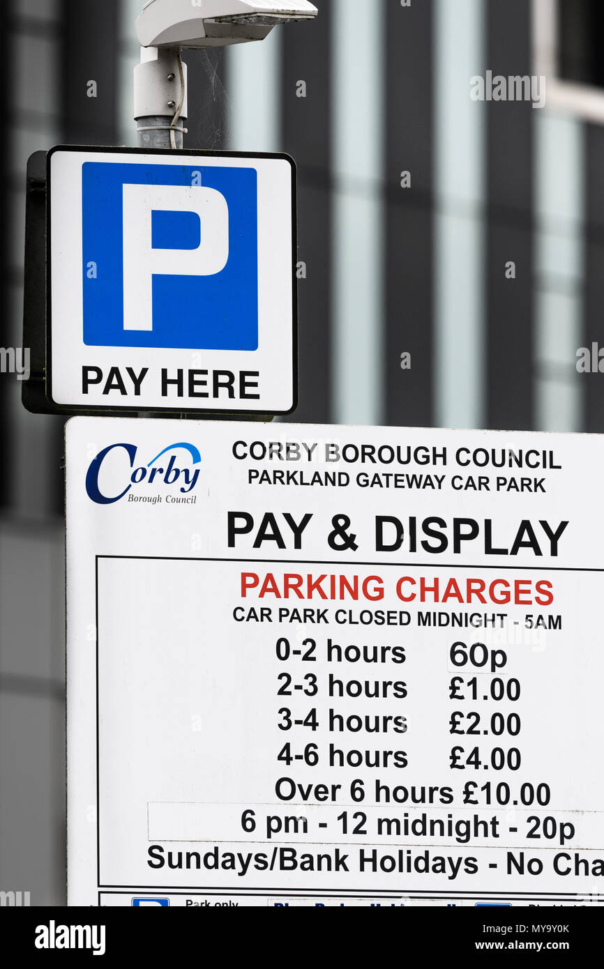 Car park pay and display parking charges notice outside the Council Cube in the town of Corby, Northamptonshire, England. - Stock Image