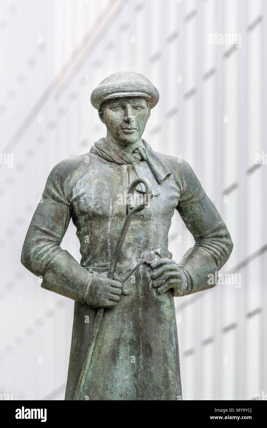 Statue, outside the Cube, Corby, to commemorate the steelmen who made PLUTO (second world cross channel pipeline) at the now defunct steelworks. Stock Photo