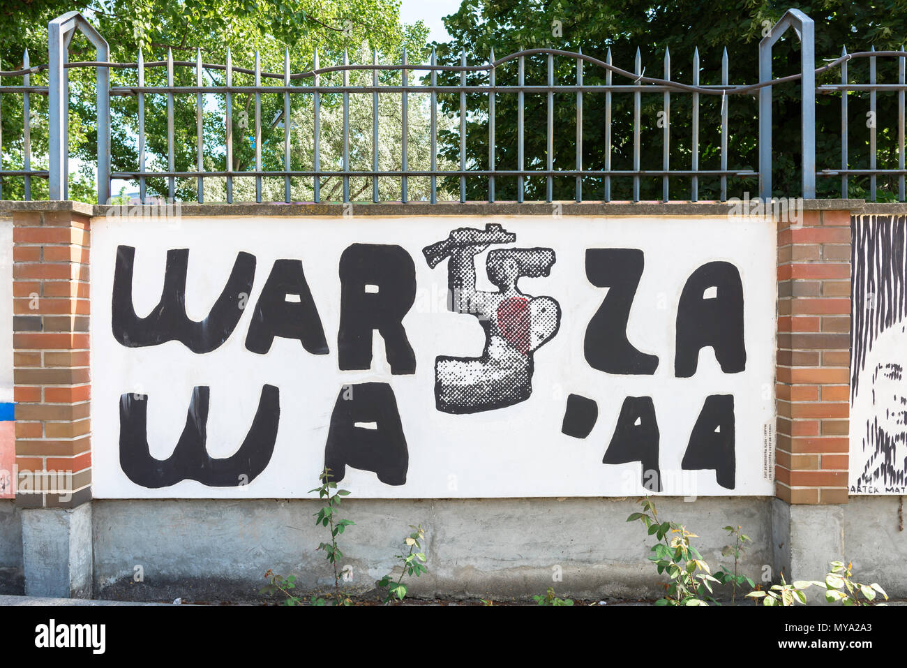 Warsaw Rising Museum, a mural in the museum rose garden showing the symbol of the Polish Home Army, Poland. - Stock Image