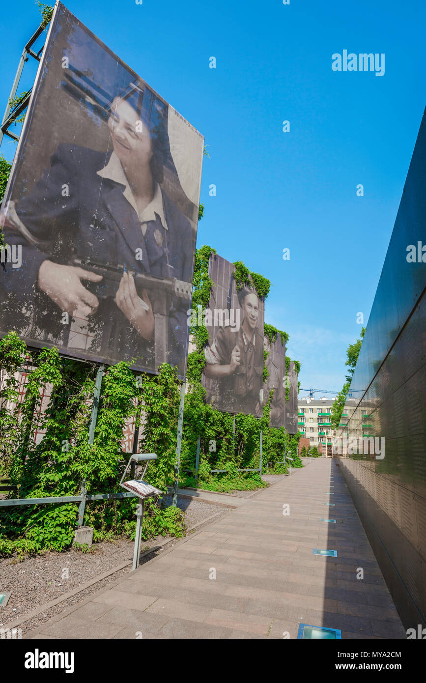 Warsaw Rising Museum, view along the museum's Avenue Of Remembrance flanked by portraits of resistance fighters and the Memorial Wall of Names,Poland - Stock Image