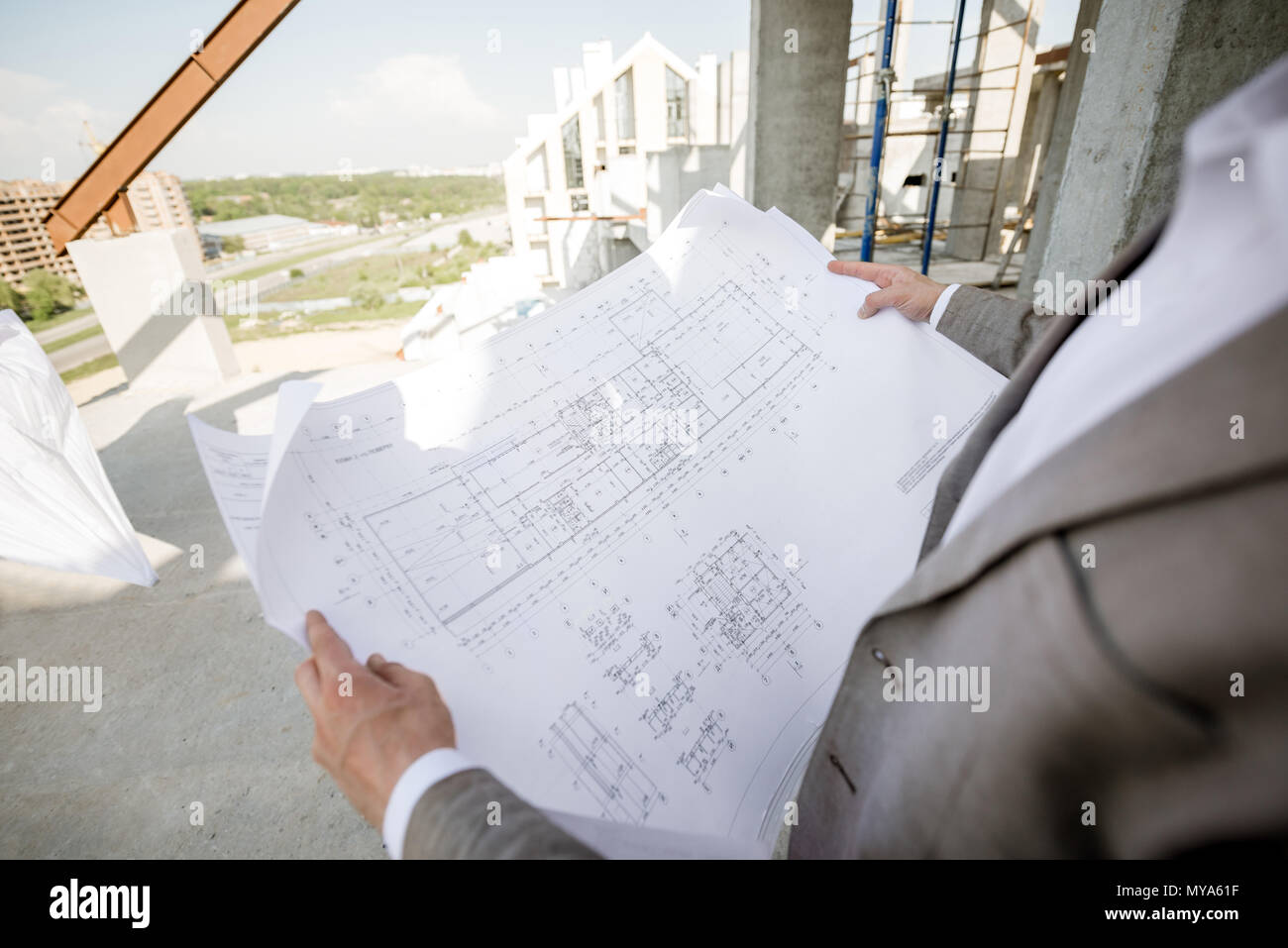 Holding house plan drawings on the structure - Stock Image