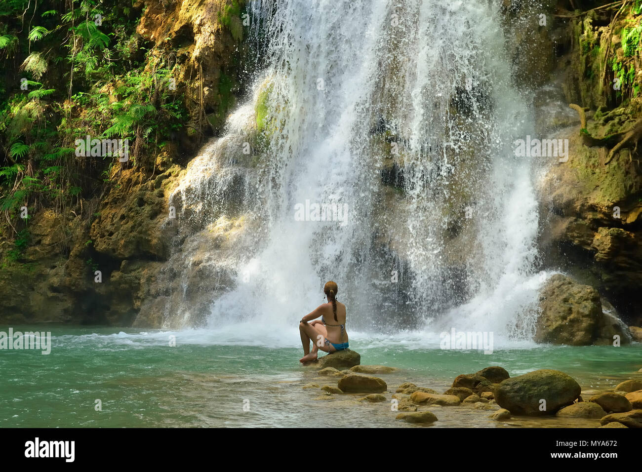 Tourist swimming in the Salto el Limon the waterfall located in the centre of the tropical forest, Samana, Dominikana Republic. - Stock Image