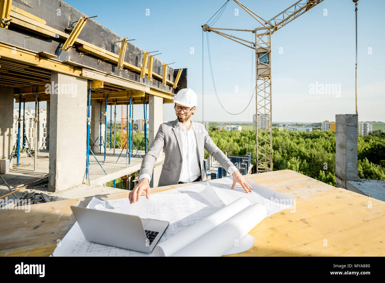 Engineer with drawings on the structure - Stock Image