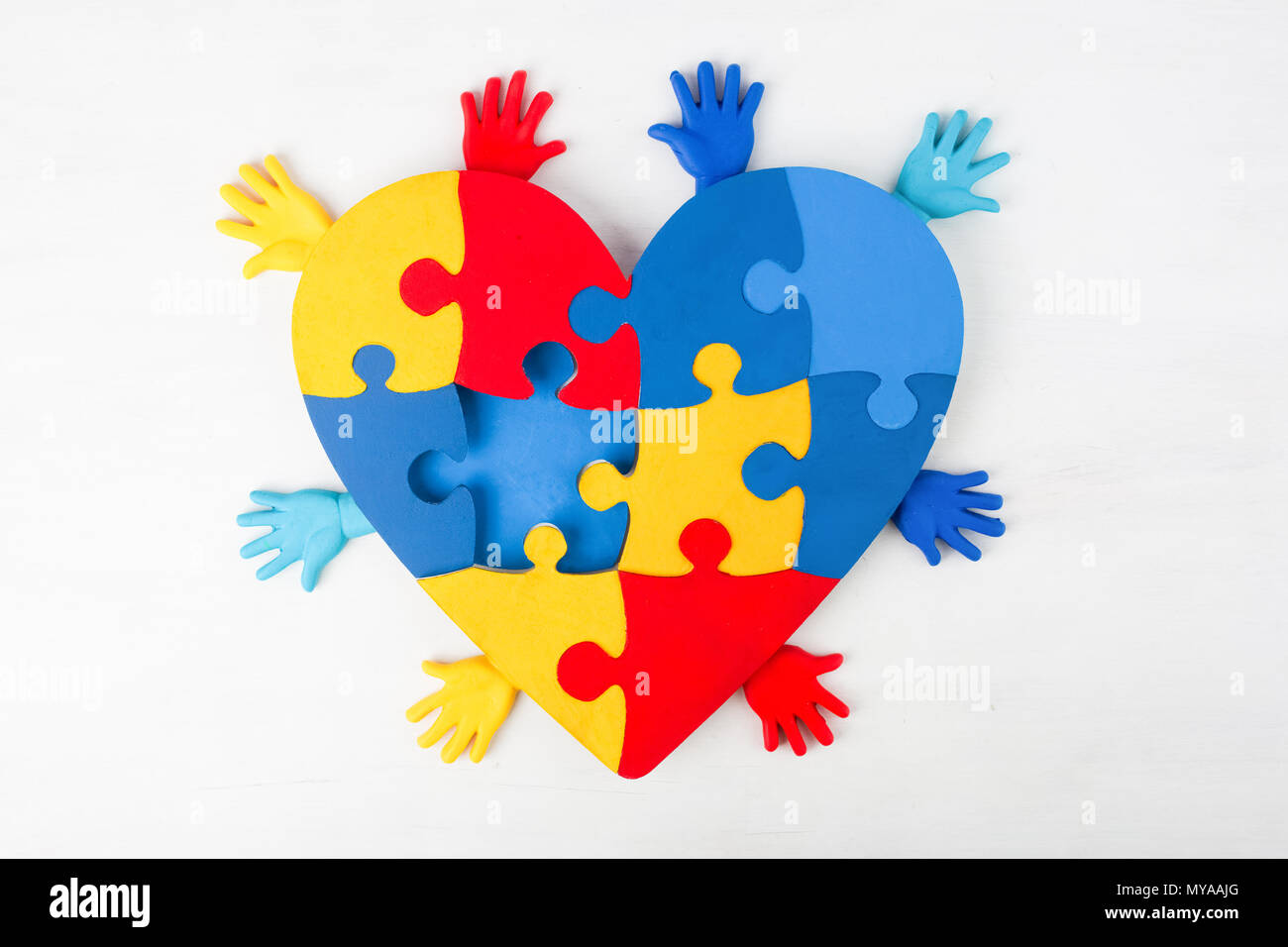 puzzle heart hands support autism awareness - Stock Image