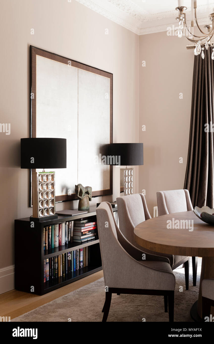 Matching lamps and dining table - Stock Image