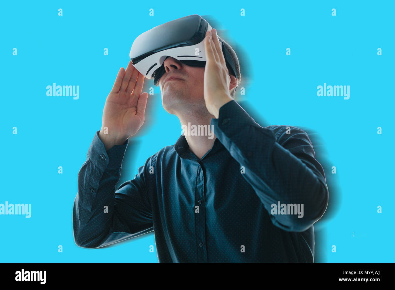 The man in the glasses of virtual reality. The concept of modern technologies and technologies of the future. VR glasses - Stock Image