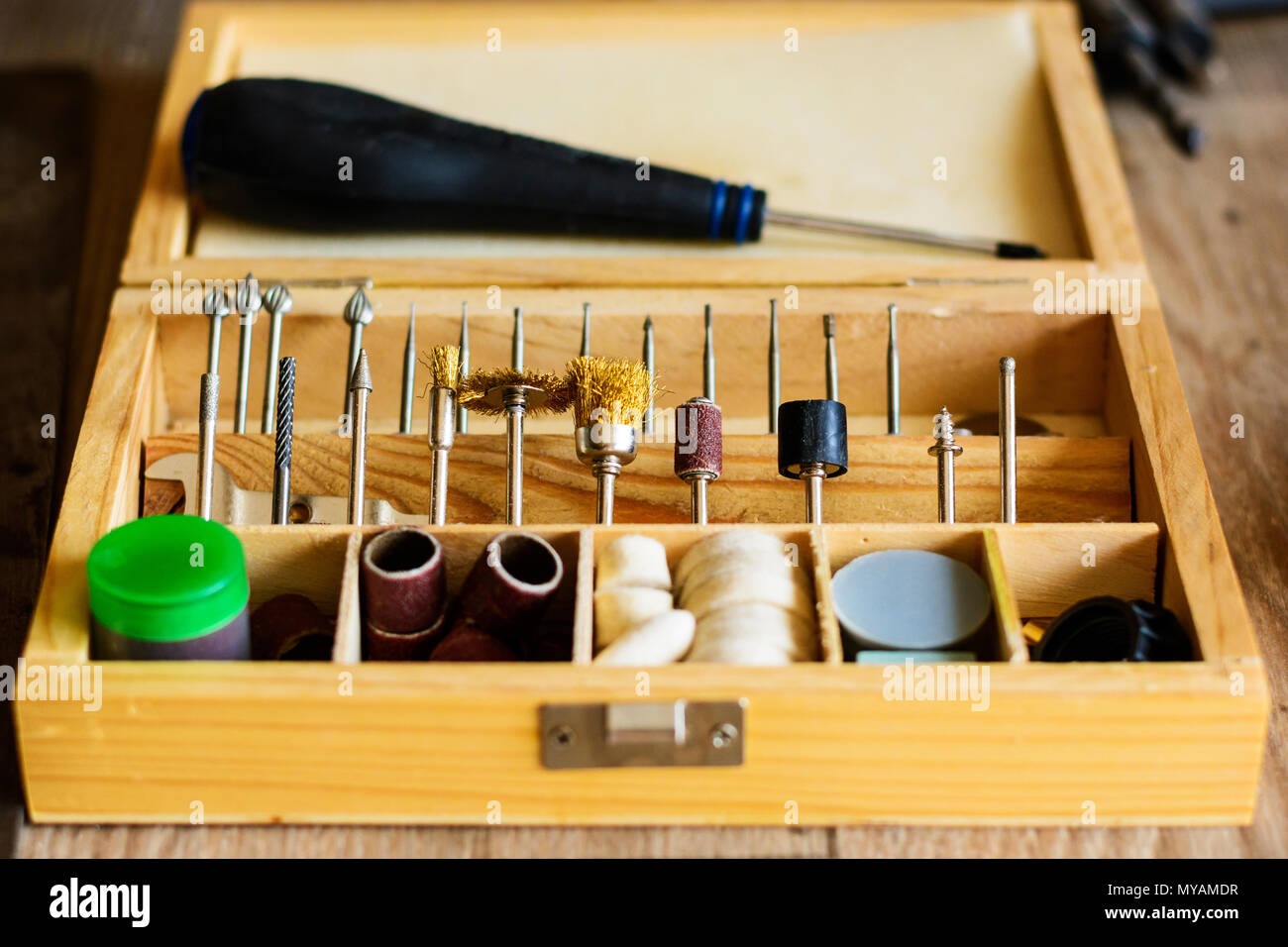 Set of small tools for grinding in a wooden case. In a carving workshop. Tools in a carving workshop. - Stock Image