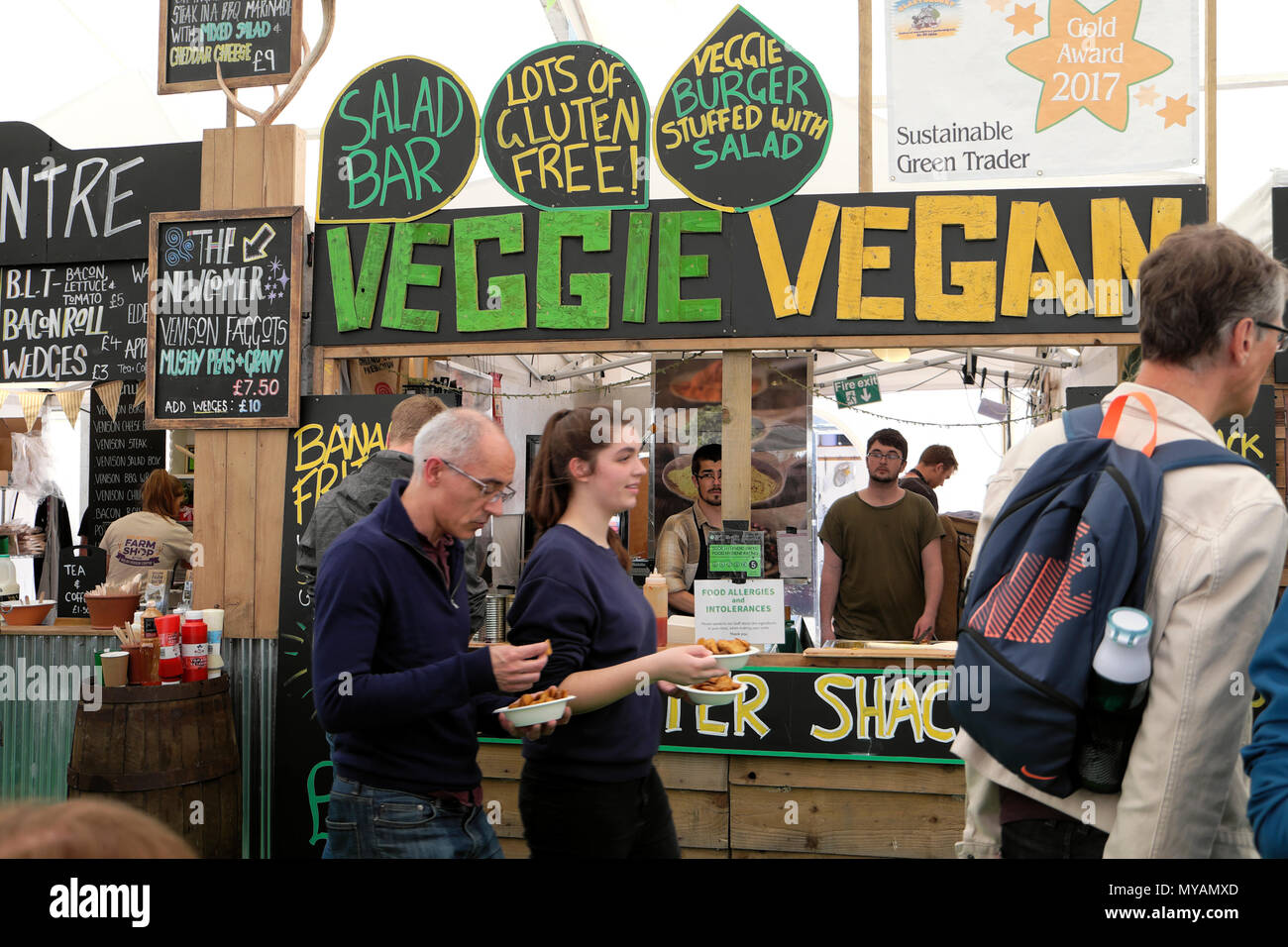 Veggie Vegan Fritter Shack and people outside food stall in the Hay Festival Food Hall at Hay-on-Wye Wales UK  KATHY DEWITT - Stock Image