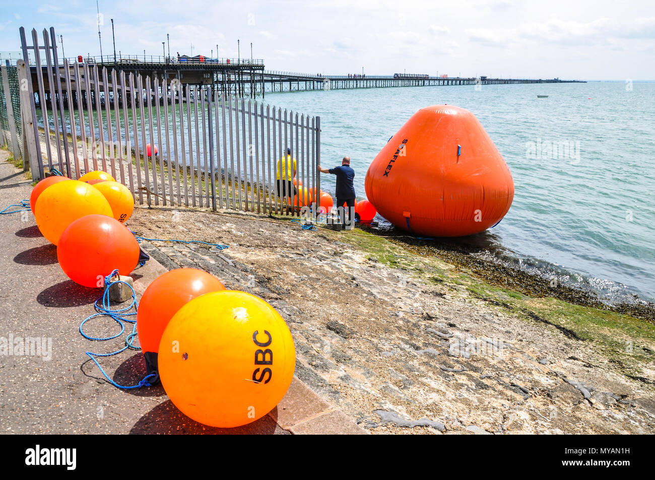 Southend Airshow clear up. Huge buoys brought back to shore which had marked out the air display line in the Thames Estuary. Southend on Sea seafront - Stock Image